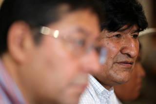 Former Bolivian President Evo Morales looks on next to the presidential candidate for the Movement to Socialism party (MAS) Luis Arce Catacora during a meeting of their party, in Buenos Aires