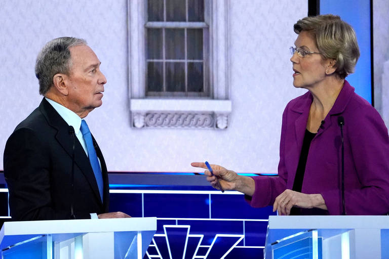 Os pré-candidatos Michael Bloomberg e Elizabeth Warren durante debate em Las Vegas