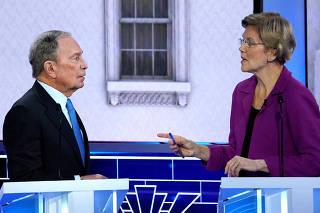 FILE PHOTO: Former New York City Mayor Bloomberg talks with Senator Warren at the ninth Democratic 2020 U.S. Presidential candidates debate in Las Vegas Nevada, U.S.