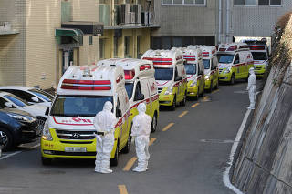 Ambulances transporting confirmed coronavirus patients arrive at a hospital in Daegu