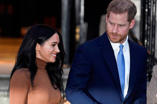 FILE PHOTO: Britain's Prince Harry and his wife Meghan, Duchess of Sussex, leave Canada House in London
