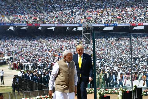US President Donald Trump (R) and India's Prime Minister Narendra Modi arrive to attend 'Namaste Trump' rally at Sardar Patel Stadium in Motera, on the outskirts of Ahmedabad, on February 24, 2020. (Photo by Mandel NGAN / AFP)
