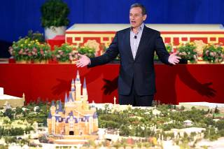 Chairman and CEO of The Walt Disney Company Bob Iger speaks in front of the unveiled scale model of the future Shanghai Disneyland during a news conference, in Shanghai