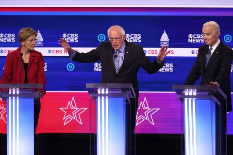 CHARLESTON, SOUTH CAROLINA - FEBRUARY 25: Democratic presidential candidate Sen. Bernie Sanders (I-VT) speaks as Sen. Elizabeth Warren (D-MA) (L) and former Vice President Joe Biden (R) look on during the Democratic presidential primary debate at the Charleston Gaillard Center on February 25, 2020 in Charleston, South Carolina. Seven candidates qualified for the debate, hosted by CBS News and Congressional Black Caucus Institute, ahead of South Carolinas primary in four days.   Win McNamee/Getty Images/AFP