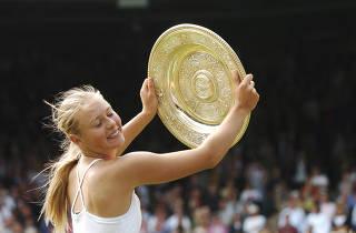FILE PHOTO: Maria Sharapova of Russia celebrates as she wins Wimbledon