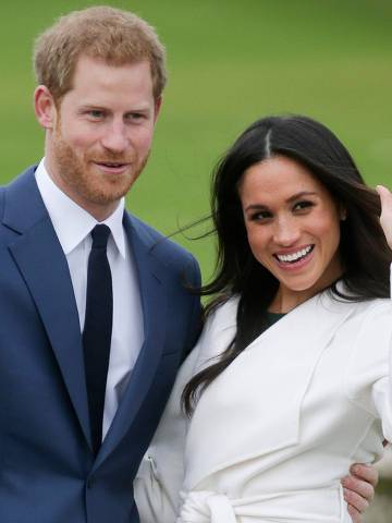(FILES) In this file photo taken on November 27, 2017 Britain's Prince Harry and his fiancée US actress Meghan Markle pose for a photograph in the Sunken Garden at Kensington Palace in west London, following the announcement of their engagement. - Britain's Prince Harry and his wife Meghan will step back as senior members of the royal family and spend more time in North America, the couple said in a historic statement Wednesday. (Photo by Daniel LEAL-OLIVAS / AFP)
