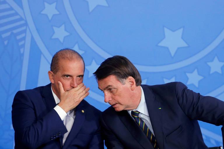 Onyx, à esquerda, e Bolsonaro, durante evento no Palácio do Planalto