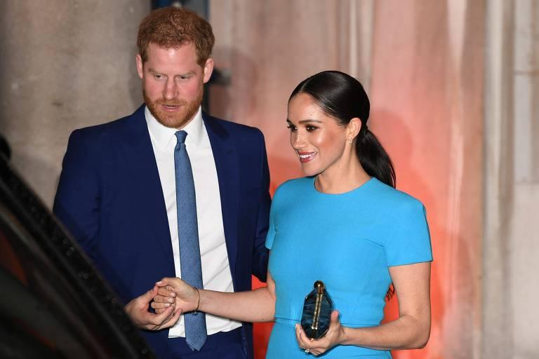 Príncipe Harry e sua mulher, Meghan, chegam para evento em Londres
