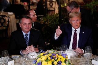 U.S. President Donald Trump participates in a working dinner with Brazilian President Jair Bolsonaro at the Mar-a-Lago resort in Palm Beach, Florida