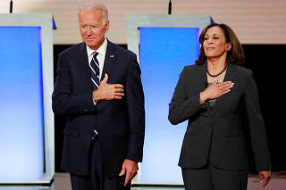 FILE PHOTO: Former Vice President  Biden and Senator Harris take the stage before the start of the second night of the second U.S. 2020 presidential Democratic candidates debate in Detroit, Michigan, U.S.