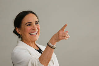 New Brazil's Culture Secretary Regina Duarte reacts during her inauguration ceremony at the Planalto Palace, in Brasilia