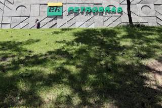 A man walks in front of the headquarters of Petroleo Brasileiro S.A. (Petrobas) in Rio de Janeiro