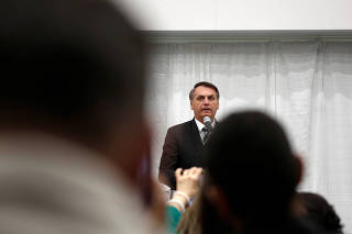Brazilian President Jair Bolsonaro speaks during a meeting with the Brazilian community at The Miami Dade College Auditorium, in Miami