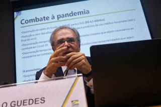 Brazil's Economy Minister Paulo Guedes speaks during a press conference to announce economic measures due the coronavirus outbreak in Brasilia