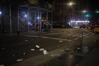 Trash litters a street in New York, March 13, 2020. (John Taggart/The New York Times)