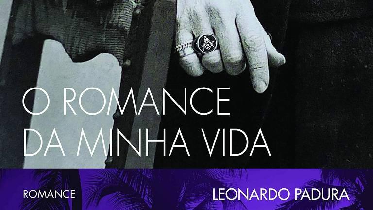 Capa mostra a mão de homem, com um anel valioso, apoiada nas costas de uma cadeira
