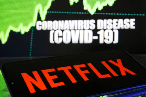 Netflix logo is seen in front of diplayed coronavirus disease (COVID-19) in this illustration taken March 19, 2020. REUTERS/Dado Ruvic/Illustration ORG XMIT: PPP-DAD04