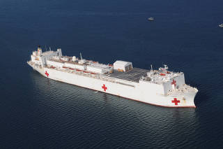 FILE PHOTO: The Military Sealift Command hospital ship USNS Comfort is anchored off the coast of Haiti