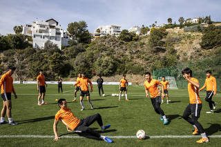 Wuhan Zall F.C. players during training at a field near Marbella, Spain, March 12, 2020. (Edu Bayer/The New York Times)
