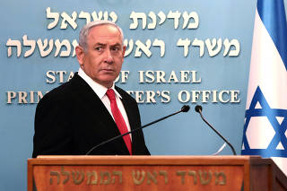 FILE PHOTO: Israeli Prime Minister Benjamin Netanyahu delivers a speech at his Jerusalem office