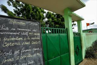 A blackboard giving information on school closings is seen in front of a closed school during the coronavirus disease (COVID-19) outbreak in Anono, Abidjan