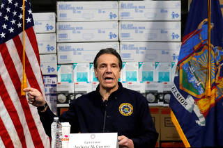 New York Governor Andrew Cuomo speaks in front of stacks of medical protective supplies at a news conference at the Jacob K. Javits Convention Center which will be partially converted into a temporary hospital during the outbreak of the coronavirus disease