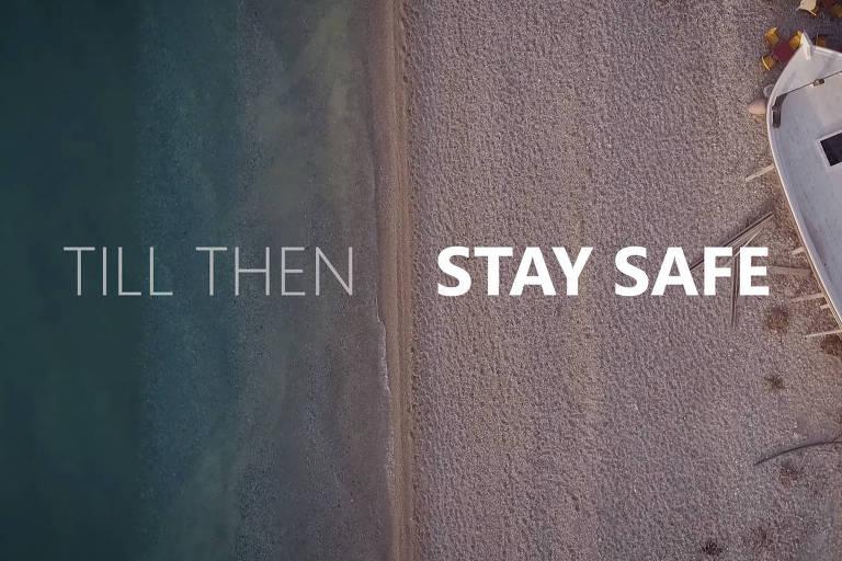 Frame de vídeo grego que pede a viajantes que conheçam o país, mas só no futuro; 'até lá, fique em segurança', diz o texto
