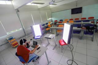 High school English teacher, Fabiano da Silva Silveira from the Colegio Israelita Brasileiro or Brazilian Israeli High School leads an online class after regular classes were suspended due to coronavirus disease (COVID-19) outbreak, in Porto Alegre