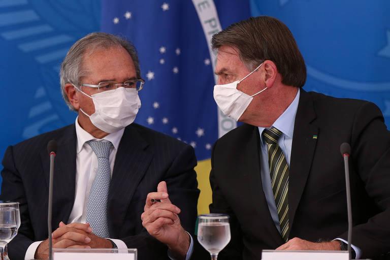 O presidente Jair Bolsonaro e Paulo Guedes durante pronunciamento no Palácio do Planalto