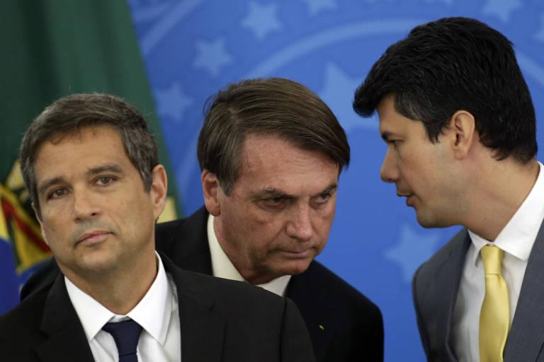 Presidente Jair Bolsonaro e os presidente do Banco Central, Roberto Campos Neto, e do BNDES, Gustavo Montezano, em pronunciamento de medidas contra o coronavírus