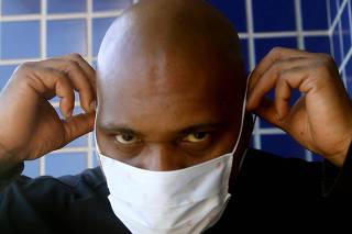 Brazilian rapper MV Bill poses as he wears a protective face mask during the coronavirus disease (COVID-19) outbreak, in Rio de Janeiro