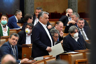 Hungarian Prime Minister Viktor Orban arrives to attend the plenary session of the Parliament ahead of a vote to grant the government special powers to combat the coronavirus disease (COVID-19) crisis in Budapest