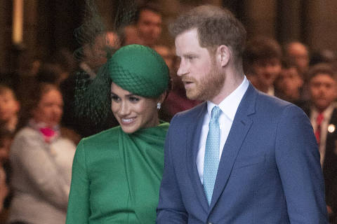 (200310) -- LONDON, March 10, 2020 (Xinhua) -- Prince Harry and his wife Meghan Markle leave Westminster Abbey after attending the annual Commonwealth Service at Westminster Abbey on Commonwealth Day in London, Britain, March 9, 2020. (Photo by Ray Tang/Xinhua)