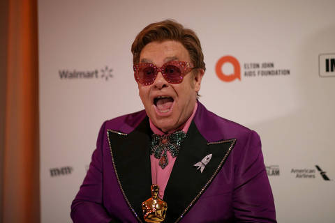 FILE PHOTO: Elton John attends the 28th Annual Elton John AIDS Foundation Academy Awards Viewing Party,  holding the Oscar for Best Original Song for