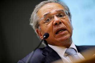 FILE PHOTO: Brazil's Economy Minister Paulo Guedes speaks during a press conference to announce economic measures due the coronavirus outbreak in Brasilia
