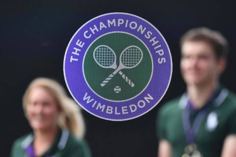(FILES) In this file photo taken on July 01, 2019 The Wimbledon emblem is seen at The All England Tennis Club in Wimbledon, southwest London, on July 1, 2019, on the first day of the 2019 Wimbledon Championships tennis tournament. - The 2020 Wimbledon Championships has been cancelled for the first time since World War II due to the coronavirus pandemic, the organisers said in a statement on April 1, 2020, as the virus wreaks further havoc on the global sporting calendar. (Photo by Daniel LEAL-OLIVAS / AFP) / RESTRICTED TO EDITORIAL USE