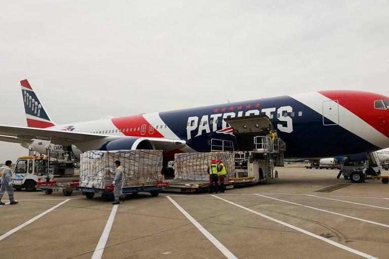 Avi�o do New England Patriots foi � China importar mais de um milh�o de m�scaras