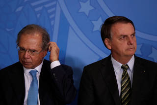 Brazil?s Economy Minster Guedes and Brazil's President Bolsonaro attend the launch of the Green and Yellow program at the Planalto Palace in Brasilia
