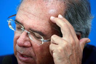 Brazil's Economy Minister Paulo Guedes gestures during a news conference amid the coronavirus disease (COVID-19) outbreak in Brasilia
