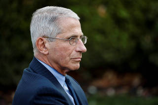 NIH National Institute of Allergy and Infectious Diseases Director Fauci listens during a news conference in the Rose Garden of the White House