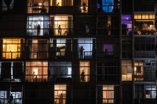Living quarters are lit up in São Paulo, Brazil, on Wednesday, March 19, 2020, where many people are staying home because of the coronavirus. (Victor Moriyama/The New York Times)