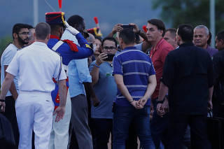 Brazil's President Jair Bolsonaro meets with faithful evangelicals and supporters in front of the Alvorada Palace, amid the coronavirus disease (COVID-19) outbreak, in Brasilia