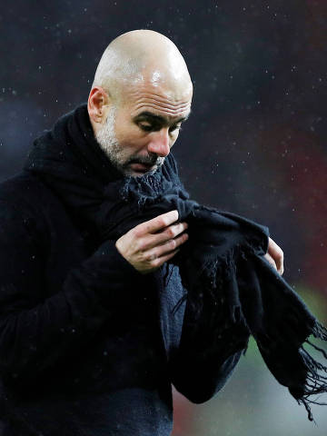 Soccer Football - Premier League - Manchester United v Manchester City - Old Trafford, Manchester, Britain - March 8, 2020  Manchester City manager Pep Guardiola looks dejected after the match    REUTERS/Phil Noble  EDITORIAL USE ONLY. No use with unauthorized audio, video, data, fixture lists, club/league logos or