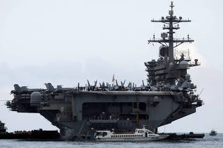 FILE PHOTO: The USS Theodore Roosevelt (CVN-71) is seen while entering into the port in Da Nang, Vietnam