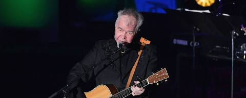 (FILES) In this file photo taken on June 13, 2019 US singer-songwriter John Prine performs onstage during the 2019 Songwriters Hall Of Fame Gala at The New York Marriott Marquis in New York City. - Grammy-winning American singer John Prine has been hospitalized for coronavirus and is in