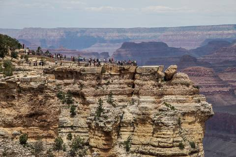 (FILES) In this file photo taken on May 15, 2019 people visit the Grand Canyon in Arizona. - The Grand Canyon was closed to visitors with immediate effect on April 1, 2020, making the Arizona landmark visited by millions each year the latest tourist hotspot to shut over the coronavirus pandemic. (Photo by Sébastien DUVAL / AFP)