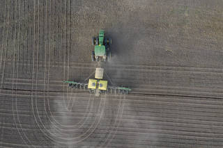 An aerial of Shane Goplin, a sixth-generation farmer growing soybeans and corn, planting corn on one of his fields outside of Osseo, Wis.