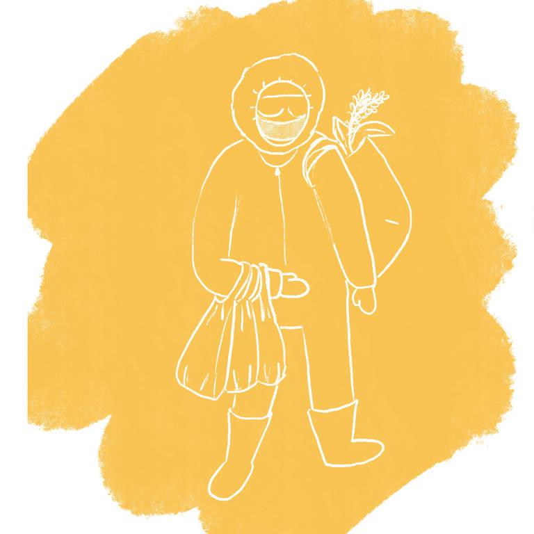 Pessoa vestida com roupa de proteção segura sacolas de compras