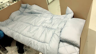 A cardboard bed is seen for passengers in Narita Airport being temporarily quarantined as they wait for the coronavirus disease (COVID-19) test results in Narita