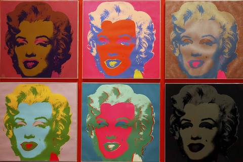 REFILE - CORRECTING SPELLING OF SURNAME - An employee poses with ten screenprints of Marilyn Monroe by Andy Warhol as part of the exhibition
